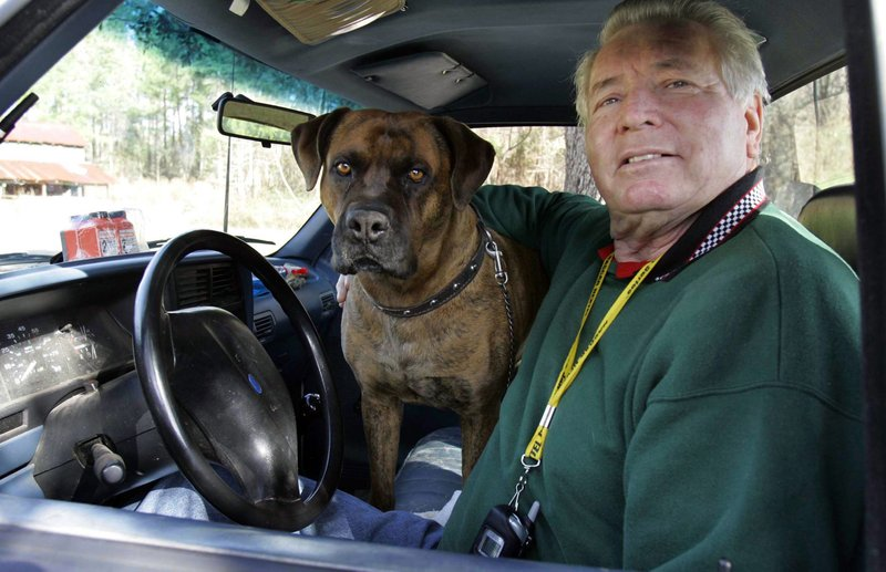 FILE - In this Jan. 11, 2007, file photo, Sam Ard sits in his car with his dog Putt Putt in Pamplico, S. (AP Photo/Mary Ann Chastain, File)