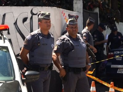Two young men wearing hoods and carrying guns, knives and crossbows opened fire at a school in southern Brazil killing eight people before taking their own lives. (March 13)