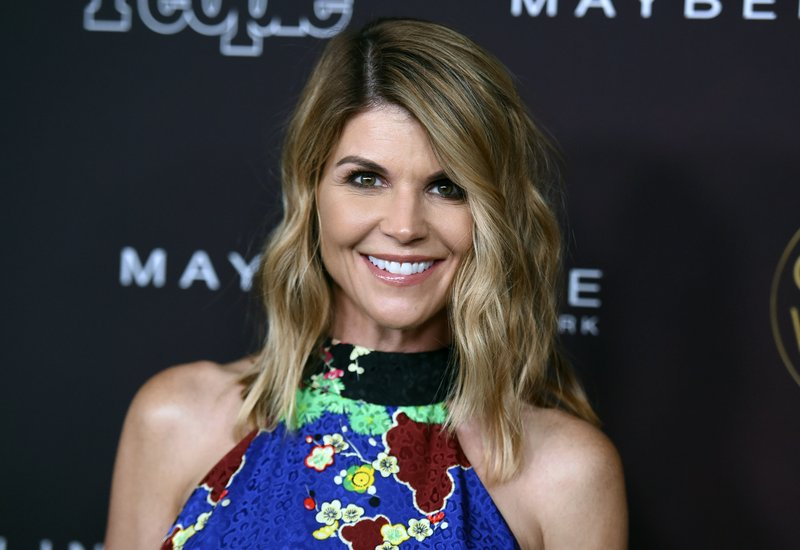 FILE - In this Oct. 4, 2017 file photo, actress Lori Loughlin arrives at the 5th annual People Magazine