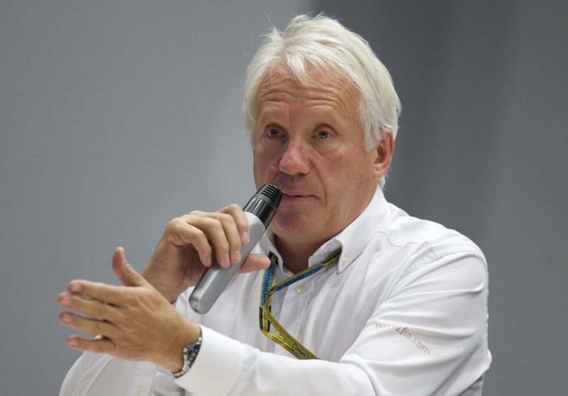 FILE - In this Oct. 10, 2014, file photo, Charlie Whiting, International Automobile Federation, or FIA, Race Director, gestures answering a question during a news conference at the 'Sochi Autodrom' Formula One circuit , in Sochi, Russia. (AP Photo/Pavel Golovkin, File)