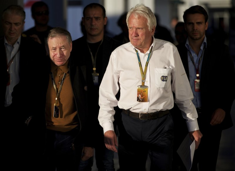 FILE - In this Oct. 10, 2014, file photo, Charlie Whiting, FIA Race Director, right, and FIA President Jean Todt, left, arrive for a news conference at the 'Sochi Autodrom' Formula One circuit , in Sochi, Russia. (AP Photo/Pavel Golovkin, File)