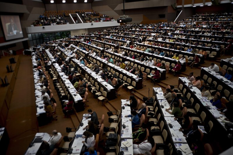 FILE - In this Dec. 21, 2018 file photo, members of the National Assembly debate the draft of a new constitution at Convention Palace in Havana, Cuba. (AP Photo/Ramon Espinosa, File)