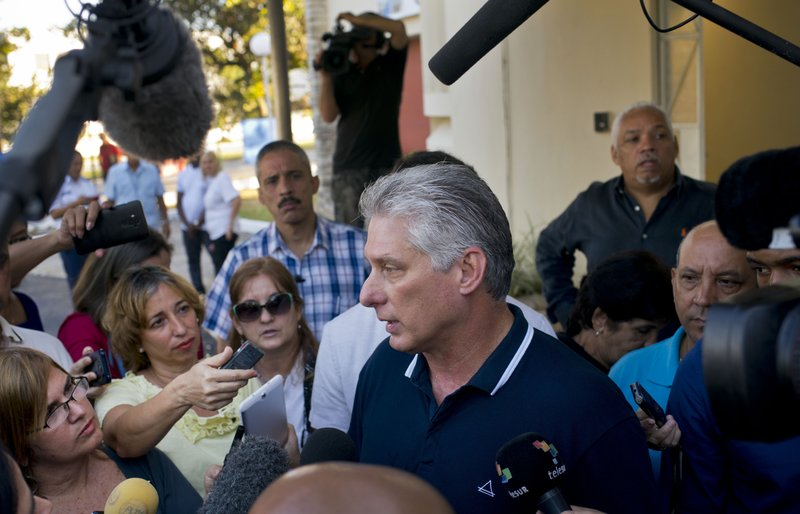 FILE - In this Feb. 24, 2019 file photo, Cuba's President Miguel Diaz-Canel talks to the press after voting in a referendum to approve or reject the new constitution in Havana, Cuba. (AP Photo/Ramon Espinosa, File)