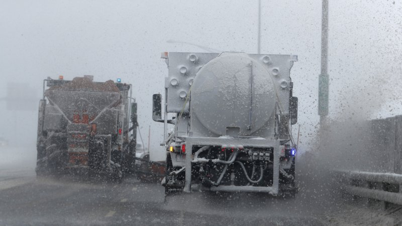 Plows work on Interstate 70 as a late winter storm packing hurricane-force winds and snow sweeps over the intermountain West Wednesday, March 13, 2019, in Denver. (AP Photo/David Zalubowski)