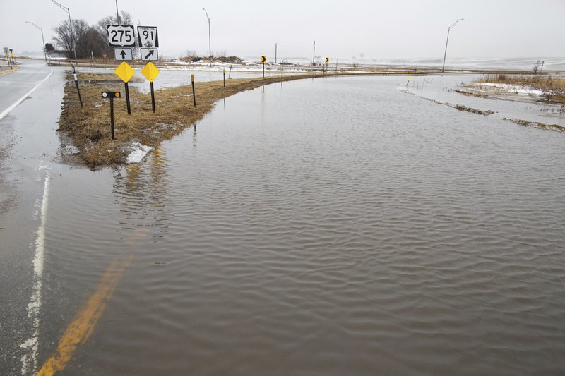 The junction of Highway 275 and Highway 91 is flooded on Wednesday, March 13, 2019, in Scribner, Neb. (Ryan Soderlin/Omaha World-Herald via AP)