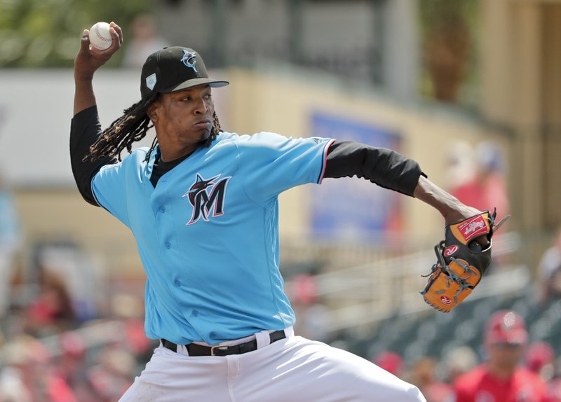 Miami Marlins starter Jose Urena (62) delivers a pitch in the first inning during an exhibition spring training baseball game against the St. (AP Photo/Brynn Anderson)