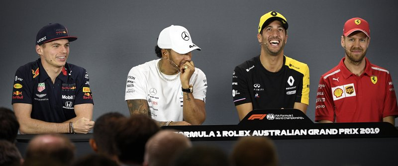 Renault driver Daniel Ricciardo, second right, of Australia jokes with Red Bull driver Max Verstappen, left, of the Netherlands, Mercedes driver Lewis Hamilton of Britain and Ferrari driver Sebastian Vettel, right, of Germany during the drivers press conference ahead of the Australian Formula One Grand Prix in Melbourne, Australia, Thursday, March 14, 2019. (AP Photo/Andy Brownbill)