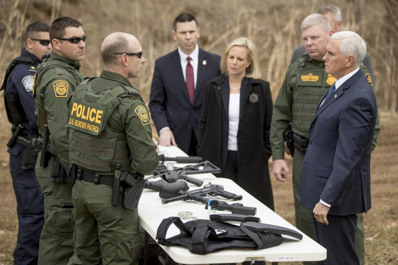 Vice President Mike Pence, right, and Homeland Security Secretary Kirstjen Nielsen, third from right, speak to Border Patrol agents before observing Border Wall Training at the U. (AP Photo/Andrew Harnik)