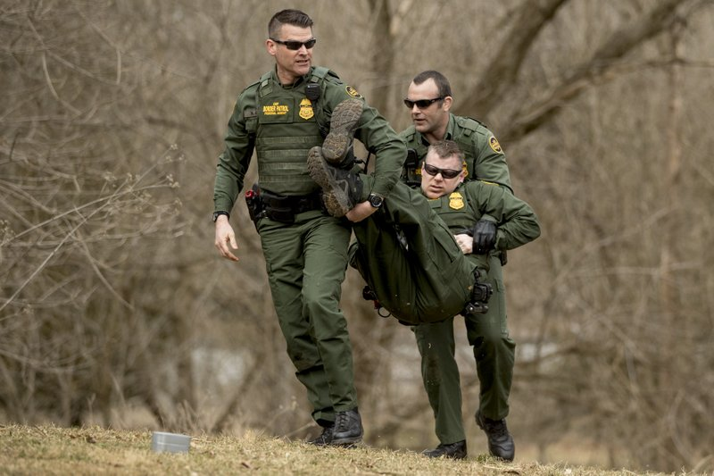 Border Patrol agents perform border wall training for Vice President Mike Pence at the U.S. Customs and Border Protection Advanced Training Facility in Harpers Ferry, W. (AP Photo/Andrew Harnik)