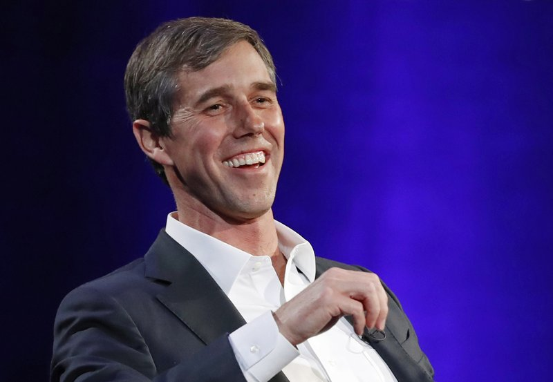 FILE - In this Tuesday, Feb. 5, 2019 file photo, former Democratic Texas congressman Beto O'Rourke laughs during a live interview with Oprah Winfrey on a Times Square stage at
