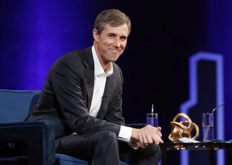 FILE - In this Feb. 5, 2019, file photo, former Democratic Texas congressman Beto O'Rourke smiles during an interview with Oprah Winfrey live on a Times Square stage at