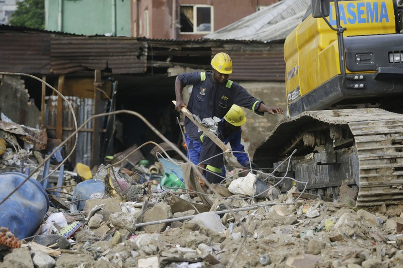 Emergency workers attend the scene after a building collapsed in Lagos, Nigeria, Thursday March 14, 2019. (AP Photo/Sunday Alamba)