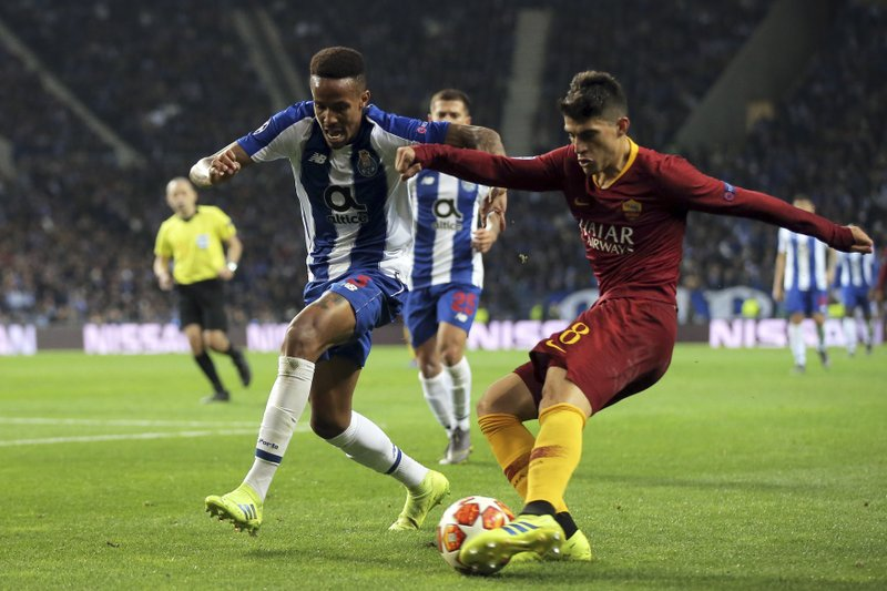 Roma forward Diego Perotti, right, vies for the ball with Porto defender Eder Militao during the Champions League round of 16, 2nd leg, soccer match between FC Porto and AS Roma at the Dragao stadium in Porto, Portugal, Wednesday, March 6, 2019. (AP Photo/Luis Vieira)