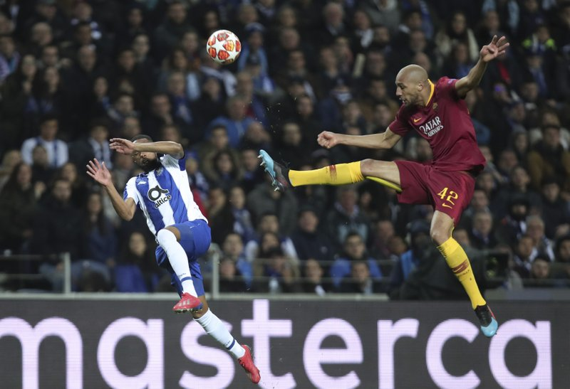 Roma midfielder Steven N'Zonzi kicks the ball in front of Porto defender Eder Militao, left, during the Champions League round of 16, 2nd leg, soccer match between FC Porto and AS Roma at the Dragao stadium in Porto, Portugal, Wednesday, March 6, 2019. (AP Photo/Luis Vieira)