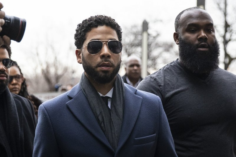 Empire actor Jussie Smollett, center, arrives at the Leighton Criminal Court Building for his hearing on Thursday, March 14, 2019, in Chicago. (Ashlee Rezin/Chicago Sun-Times via AP)