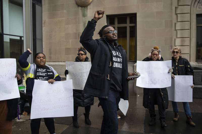 Supporters of Jussie Smollett rally outside the Leighton Criminal Courthouse, where the actor was scheduled to appear for a hearing, Thursday, March 14, 2019. (Ashlee Rezin/Chicago Sun-Times via AP)
