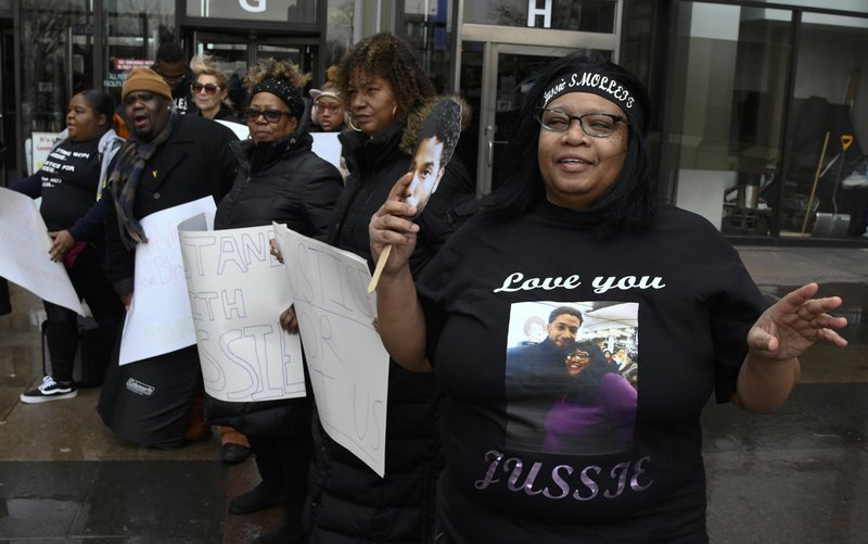 Empire actor Jussie Smollett supporter, Sandra Gentry, right, and others , talk as Smollett arrives at the Leighton Criminal Court Building for his hearing on Thursday, March 14, 2019, in Chicago. (AP Photo/Matt Marton)