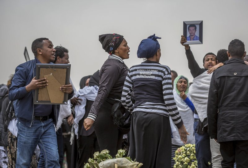 Ethiopian relatives of crash victims mourn at the scene where the Ethiopian Airlines Boeing 737 Max 8 crashed shortly after takeoff on Sunday killing all 157 on board, near Bishoftu, south-east of Addis Ababa, in Ethiopia Thursday, March 14, 2019. (AP Photo/Mulugeta Ayene)