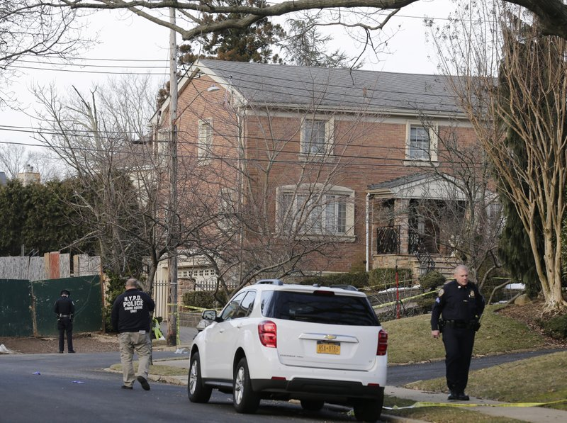 Police work near the scene where an alleged leader of the Gambino crime family was shot and killed in the Staten Island borough of New York, Thursday, March 14, 2019. (AP Photo/Seth Wenig)