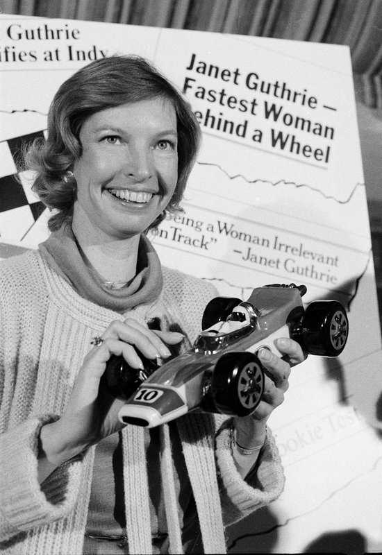 FILE - This April 6, 1978, file photo shows Janet Guthrie posing with a toy race car at a news conference in New York. (AP Photo/Marty Lederhandler, File)