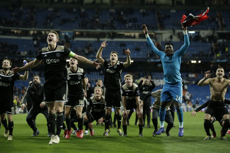 Ajax players celebrate after the Champions League round of 16 second leg soccer match between Real Madrid and Ajax at the Santiago Bernabeu stadium in Madrid, Tuesday, March 5, 2019. (AP Photo/Bernat Armangue)
