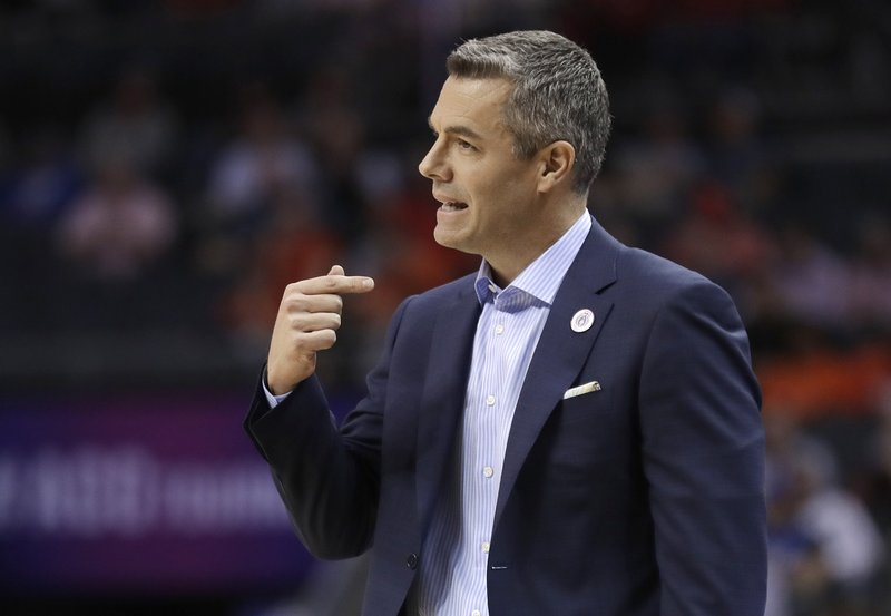 Virginia head coach Tony Bennett directs his team against North Carolina State during the first half of an NCAA college basketball game in the Atlantic Coast Conference tournament in Charlotte, N. (AP Photo/Nell Redmond)