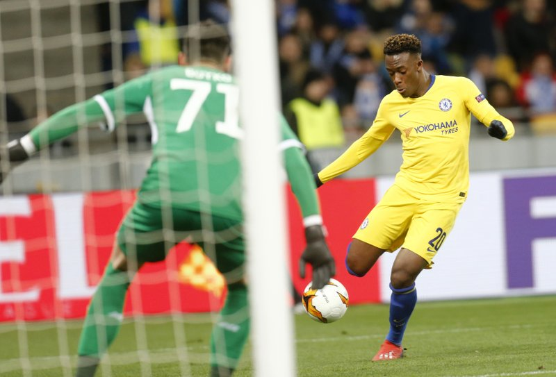 Chelsea's Davide Hudson-Odoi scores his side's fifth goal during the Europa League round of 16, second leg soccer match between Dynamo Kiev and Chelsea at the Olympiyskiy stadium in Kiev, Ukraine, Thursday, March 14, 2019. (AP Photo/Efrem Lukatsky)