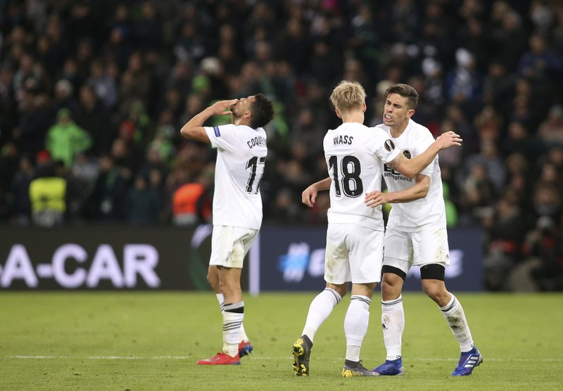 Valencia's team players c celebrate their victory after the Europa League round of 16, second leg soccer match between FC Krasnodar and Valencia at the Krasnodar Stadium in Krasnodar, Russia, Thursday, March 14, 2019. (AP Photo/Vitaliy Timkiv)