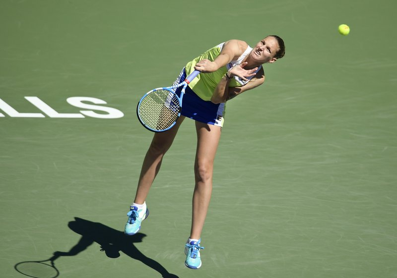 Karolina Pliskova, of the Czech Republic, serves to Belinda Bencic, of Switzerland, at the BNP Paribas Open tennis tournament Thursday, March 14, 2019, in Indian Wells, Calif. (AP Photo/Mark J. Terrill)
