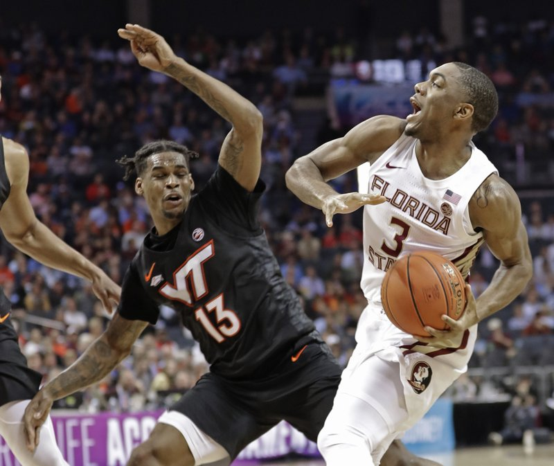 Florida State's Trent Forrest (3) drives against Virginia Tech's Ahmed Hill (13) during the first half of an NCAA college basketball game in the Atlantic Coast Conference tournament in Charlotte, N. (AP Photo/Nell Redmond)