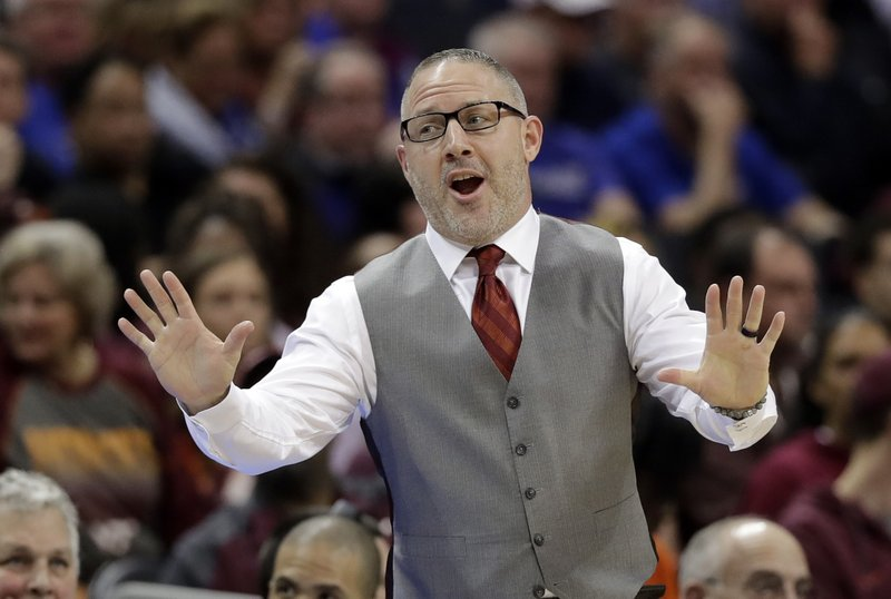 Virginia Tech head coach Buzz Williams jokes with Florida State head coach Leonard Hamilton, not shown, during the first half of an NCAA college basketball game in the Atlantic Coast Conference tournament in Charlotte, N. (AP Photo/Chuck Burton)