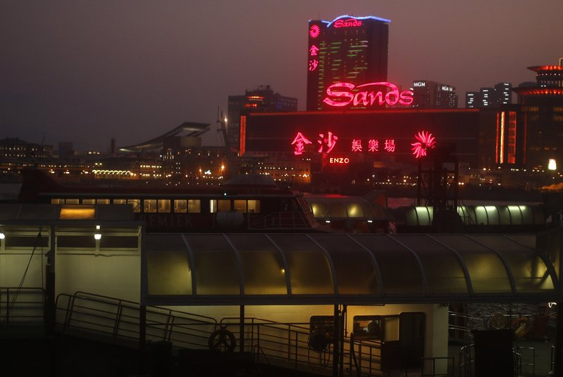 FILE - In this May 25, 2012 file photo, Sands Casino complex is lit up in Macau. Jurors considering how much a Hong Kong businessman should receive from Las Vegas Sands Corp. (AP Photo/Vincent Yu, File)