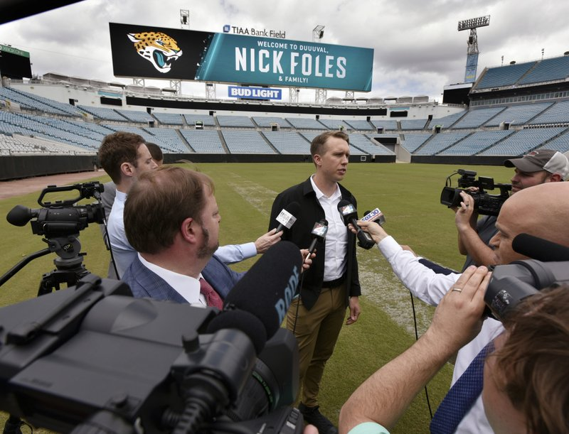 Newly signed Jacksonville Jaguars NFL football quarterback Nick Foles talks to the media at TIAA Bank Field in Jacksonville, Fla., Thursday, March 14, 2019  [Will Dickey/The Florida Times-Union via AP)