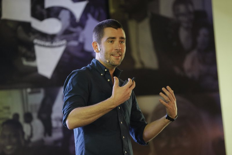FILE- In this Feb. 27, 2017, file photo Facebook's Chief of Product officer, Chris Cox, speaks at the first day of the social media week at the Landmark centre in Lagos, Nigeria. (AP Photo/Sunday Alamba, File)