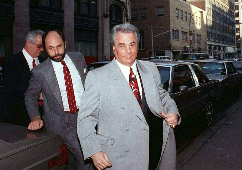 FILE - In this Feb. 9, 1990 file photo, John Gotti, right, arrives at court in New York. The Gambino family was once among the most powerful criminal organizations in the U. (AP Photo/David Cantor, File)
