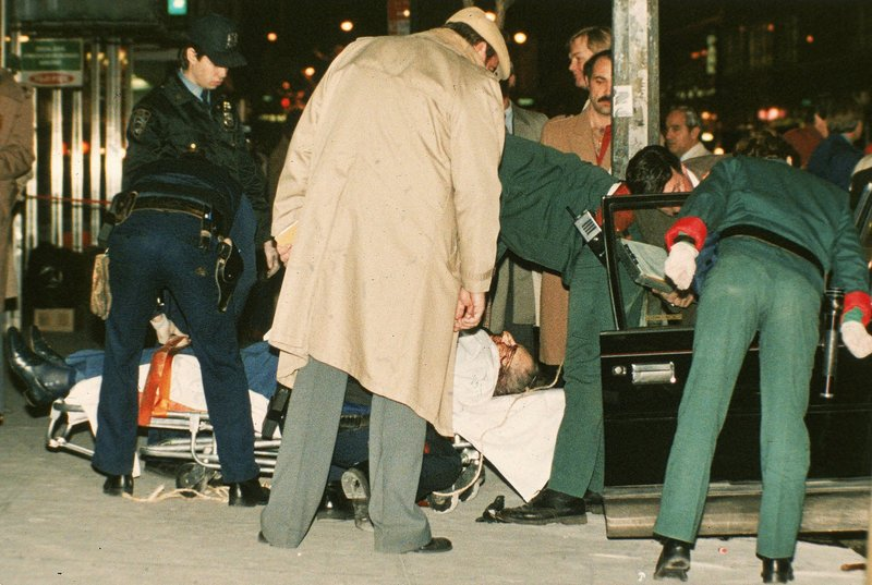 FILE - In this Dec. 16, 1985 file photo, the body of mafia crime boss Paul Castellano lies on a stretcher outside the Sparks Steak House in New York after he and his bodyguards were gunned down at the direction of John Gotti, who then took over as boss. (AP Photo/Mario Suriani, File)