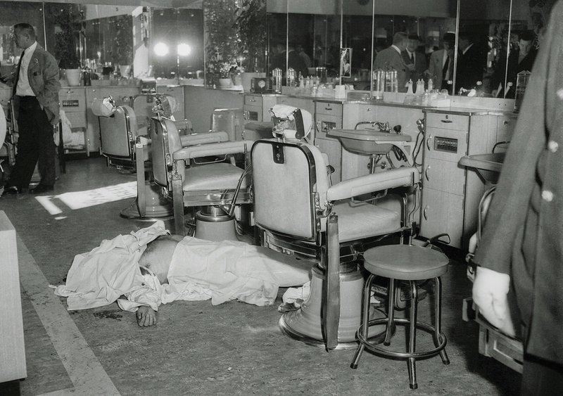 FILE - In this Oct. 25, 1957 file photo, the body of Mafia boss Albert Anastasia lies on the floor of the barbershop at New York's Park Sheraton Hotel after his murder. (AP Photo/FILE)