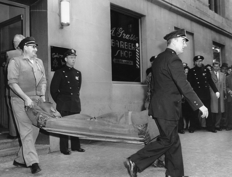 FILE - In this Oct. 25, 1957 file photo, the body of gangster Albert Anastasia is carried by stretcher from the A. (AP Photo/File)
