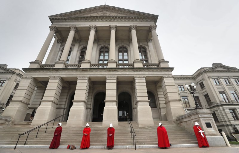 Georgia members of the Handmaid Coalition protest the passage of HB 481 outside the Capitol, Friday, March 8, 2019, in Atlanta. (Bob Andres/Atlanta Journal-Constitution via AP)