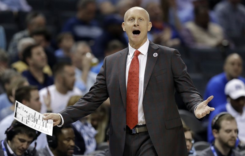 Louisville head coach Chris Mack reacts to a call during the first half of an NCAA college basketball game against North Carolina in the Atlantic Coast Conference tournament in Charlotte, N. (AP Photo/Chuck Burton)