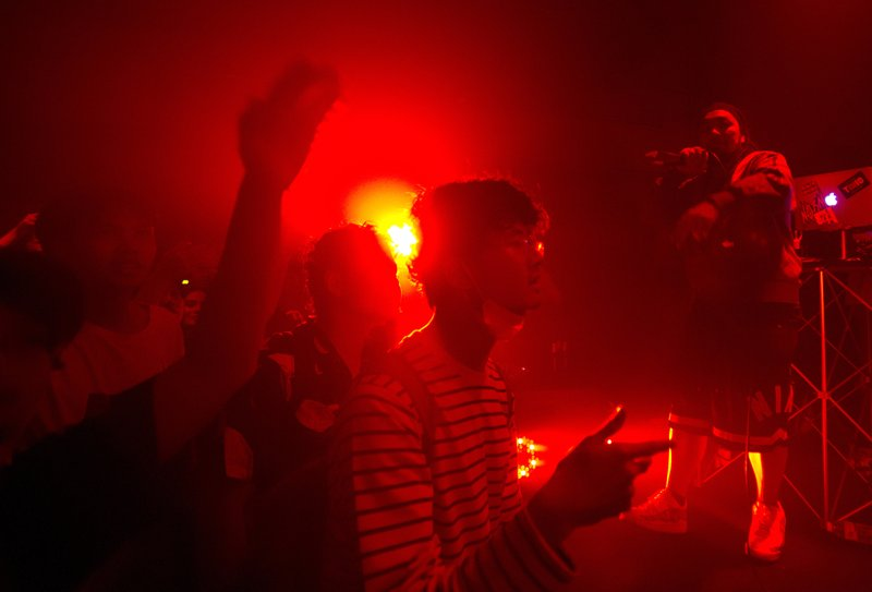 In this Saturday, Feb. 23, 2019, a young audience attends a Rap Against Dictatorship, who's songs have condemned the military's involvement in government, concert in Bangkok, Thailand. (AP Photo/Sakchai Lalit)