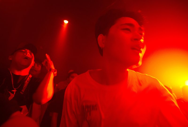 In this Saturday, Feb. 23, 2019, young Thais enjoy a concert by Rap Against Dictatorship, who's songs have condemned the military's involvement in government, in Bangkok, Thailand. (AP Photo/Sakchai Lalit)