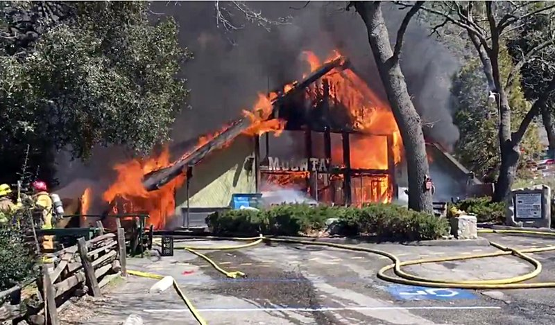This photo provided by the San Bernardino County Sheriff's Office shows a fire at the Mountain Town Reptile Museum in Oak Glen, Calif. (San Bernardino County Sheriff's Office via AP)