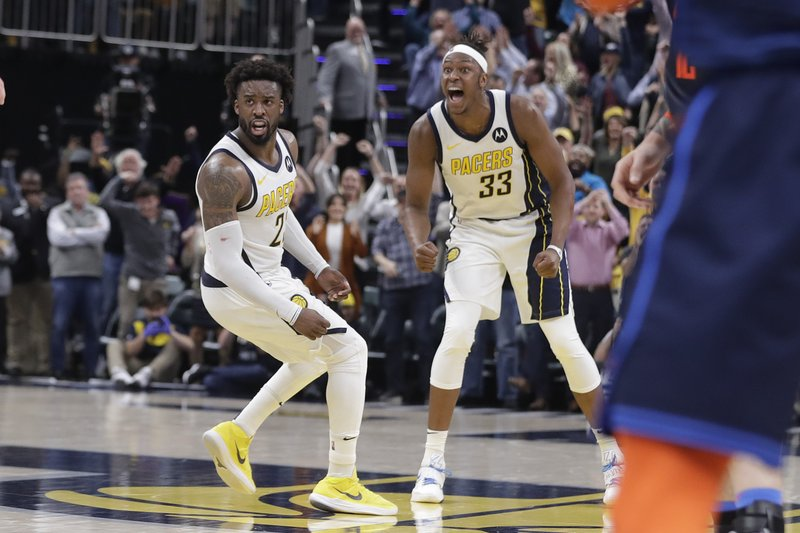 Indiana Pacers' Wesley Matthews (23) and Myles Turner (33) celebrate during the second half of an NBA basketball game against the Oklahoma City Thunder,Thursday, March 14, 2019, in Indianapolis. (AP Photo/Darron Cummings)