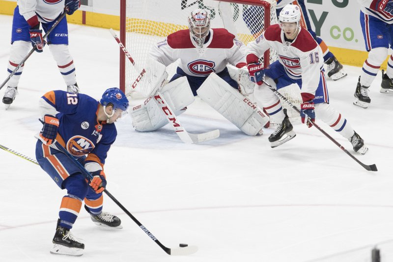 Montreal Canadiens goaltender Carey Price (31) and center Jesperi Kotkaniemi (15) tends net against New York Islanders right wing Josh Bailey (12) during the third period of an NHL hockey game, Thursday, March 14, 2019, in Uniondale, N. (AP Photo/Mary Altaffer)