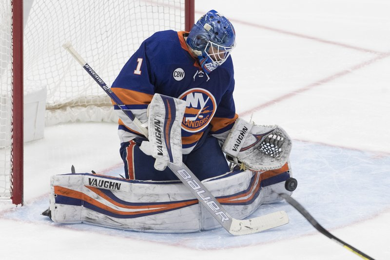 New York Islanders goaltender Thomas Greiss makes a save during the third period of the team's NHL hockey game against the Montreal Canadiens, Thursday, March 14, 2019, in Uniondale, N. (AP Photo/Mary Altaffer)