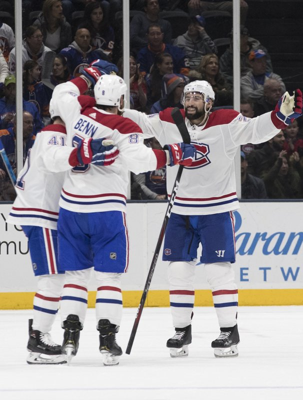 Montreal Canadiens defenseman Jordie Benn, center, celebrates after scoring a goal during the second period of an NHL hockey game against the New York Islanders, Thursday, March 14, 2019, in Uniondale, N. (AP Photo/Mary Altaffer)