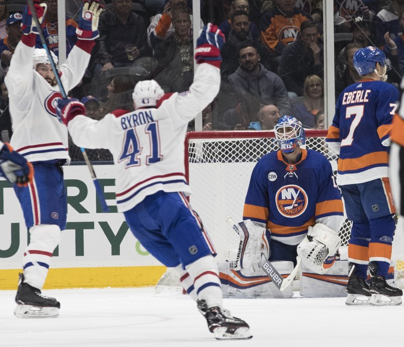 New York Islanders goaltender Thomas Greiss (1) and Montreal Canadiens left wing Paul Byron (41) react after defenseman Jordie Benn (not shown) scored a goal during the second period of an NHL hockey game, Thursday, March 14, 2019, in Uniondale, N. (AP Photo/Mary Altaffer)