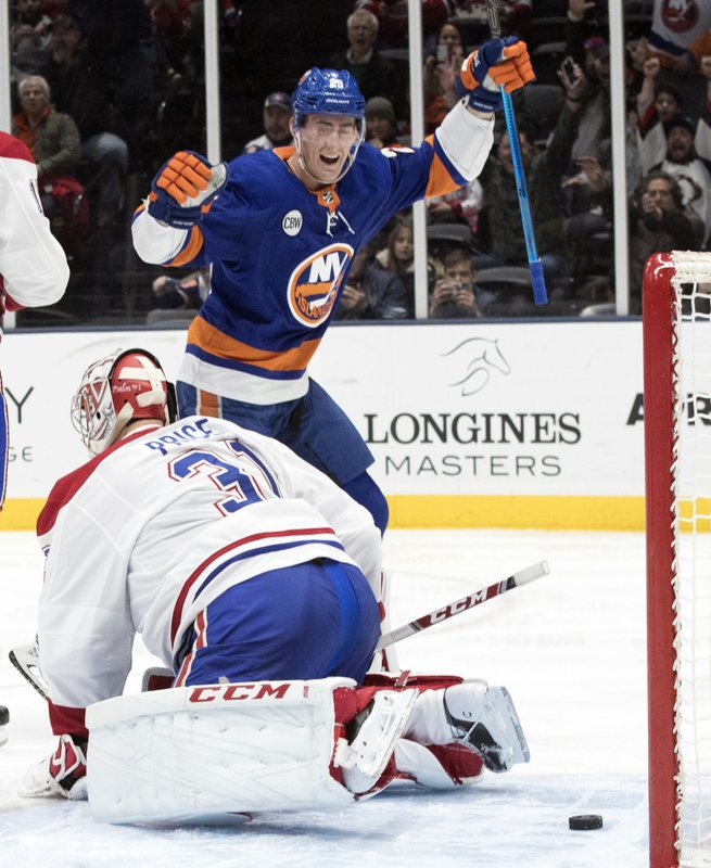 New York Islanders center Brock Nelson (29) reacts after defenseman Adam Pelech (not shown) scored a goal past Montreal Canadiens goaltender Carey Price (31) during the second period of an NHL hockey game, Thursday, March 14, 2019, in Uniondale, N. (AP Photo/Mary Altaffer)
