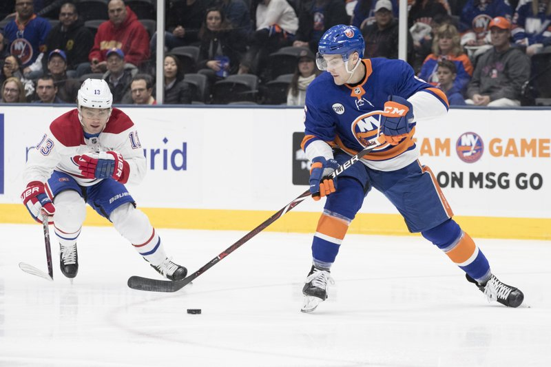 New York Islanders defenseman Ryan Pulock (6) skates against Montreal Canadiens center Max Domi (13) during the first period of an NHL hockey game, Thursday, March 14, 2019, in Uniondale, N. (AP Photo/Mary Altaffer)